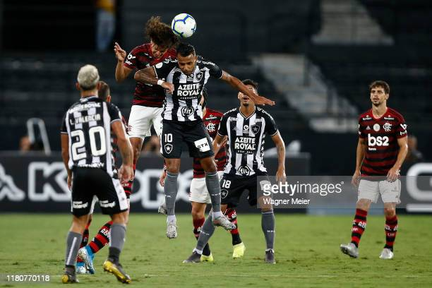 Alex Santana of Botafogo and Willian Arao of Flamengo jump for the ball during a match between Botafogo and Flamengo as part of Brasileirao Series A...
