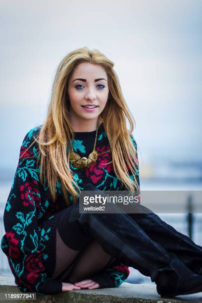 alex sat by the mersey - models in stockings stock pictures, royalty-free photos & images