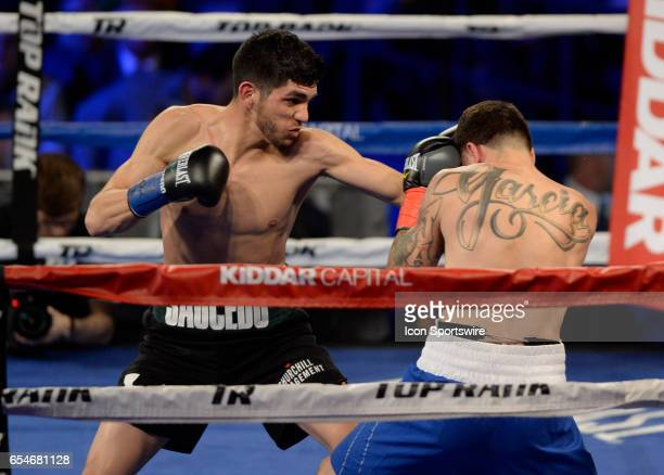Alex Saucedo battles Johnny Garcia during their Welterweight bout on March 17 2017 at the The Theater at Madison Square Garden in New York City New...