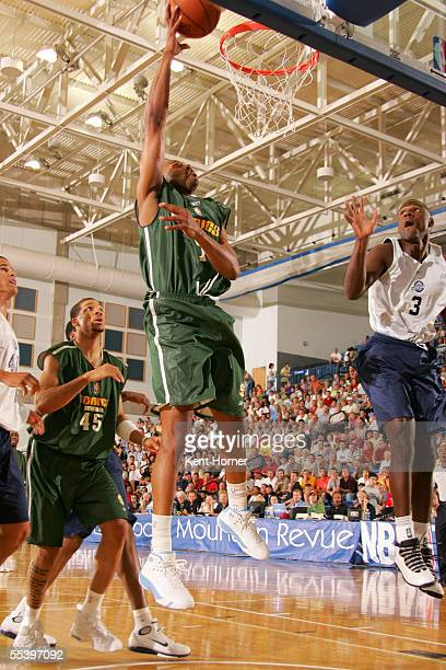Alex Scales of the Seattle SuperSonics attempts a shot against the Utah  Jazz during the Reebok 3cff3a9c8