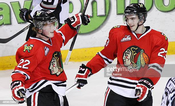 Alex Schoenborn and Dominic Turgeon of the Portland Winterhawks celebrate Alex Schoenborn's goal against the Vancouver Giants during the second...