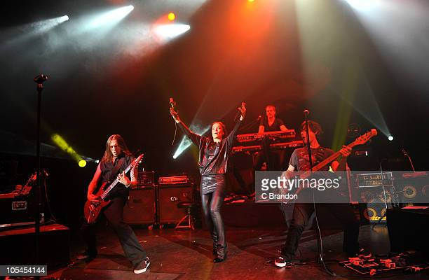 Alex Scholpp, Tarja Turunen, Christian Kretschmar and Kevin Chown perform on stage at Shepherds Bush Empire on October 13, 2010 in London, England.