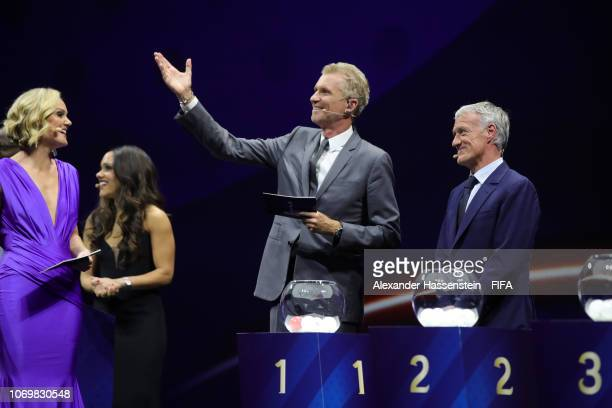 Alex Scott and Didier Deschamps on stage with draw moderators Amanda Davies and Denis Brogniart during the FIFA Women's World Cup France 2019 Draw at...