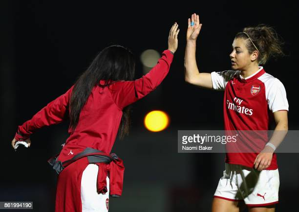 Alex Scott congratulates teammate Jemma Rose during the FA Women's Super League Continental Cup match between Arsenal and London Bees on October 12...