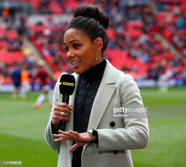 Alex Scott Ex Arsenal player during The SSE Women's FA Cup Final match between Manchester City Women and West Ham United at Wembley stadium London on...