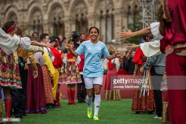 Alex Scott is being greeted during the Legends Football Match in Red Square on July 11 2018 in Moscow Russia