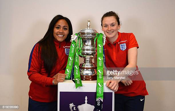 Alex Scott of Arsenal and Rachel Laws of Sunderland SemiFinalists of the SSE Women's FA Cup pose with the SSE Women's FA Cup during the England Women...