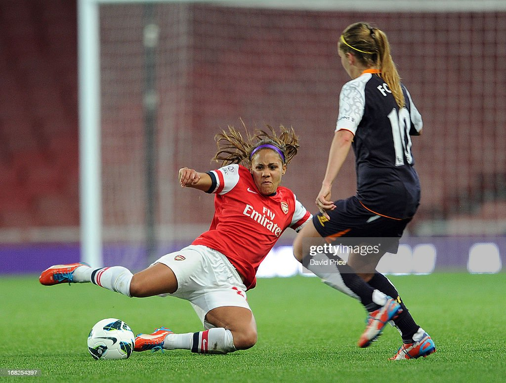 Alex Scott of Arsenal challenges Louise Fors of Liverpool during the FA Women's Super League match between Arsenal Ladies FC and Liverpool Ladies FC at Emirates Stadium on May 07, 2013 in London, England.