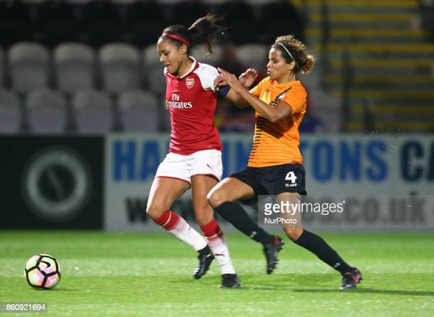 Alex Scott of Arsenal holds of Destiney Toussaint of London Bees during The FA WSL Continental Tyres Cup match between Arsenal against London Bees at...