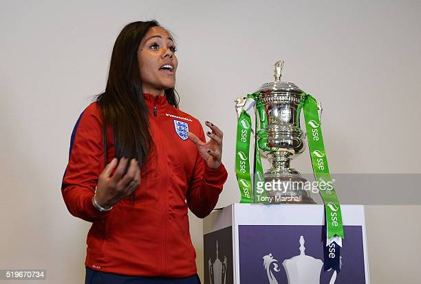 Alex Scott of Arsenal poses with the SSE Women's FA Cup during the England Women Training Session at St Georges Park on April 5 2016 in...