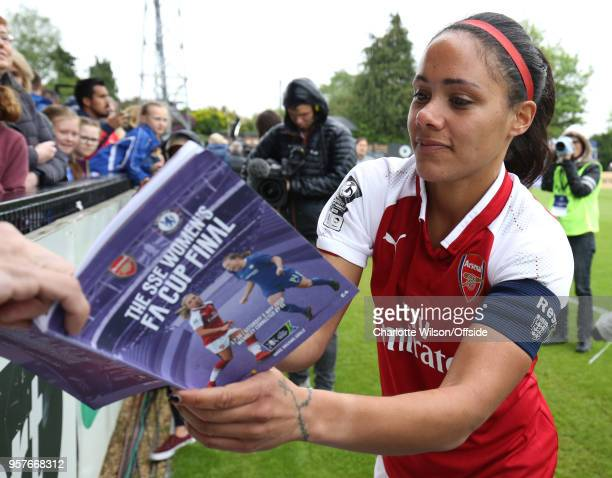 Alex Scott of Arsenal signs a programme for a fan during the Womens Super League match between Arsenal Ladies and Manchester City Women at Meadow...