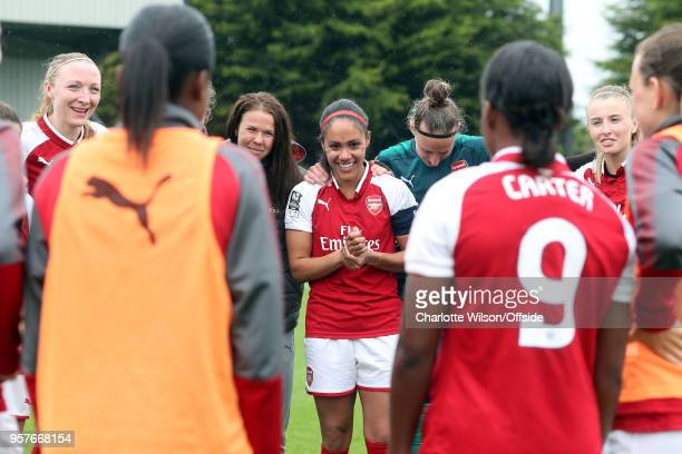 Alex Scott of Arsenal smiles in the team huddle after her last home game before retirement during the Womens Super League match between Arsenal...