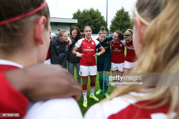 Alex Scott of Arsenal speaks to her teammates in the huddle after her last home game before retirement during the Womens Super League match between...