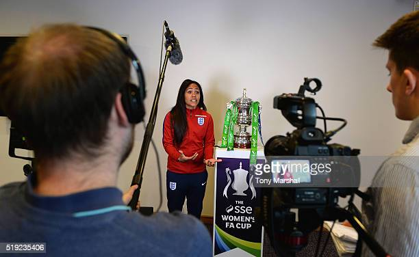 Alex Scott of Arsenal speaks to the media next to the SSE Women's FA Cup before the England Women's Training Session at St Georges Park on April 5...