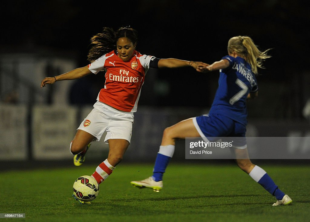 Alex Scott of Arsenal takes on Nadia Lawrence of Bristol during the WSL match between Arsenal Ladies and Bristol Academy at Meadow Park on April 15, 2015 in Borehamwood, England.
