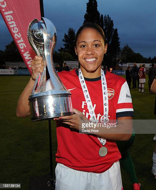 Alex Scott of Arsenal with the WSL Trophy after the FA Women's Super League match between Arsenal Ladies FC and Doncaster Rovers Belles Ladies FC at...