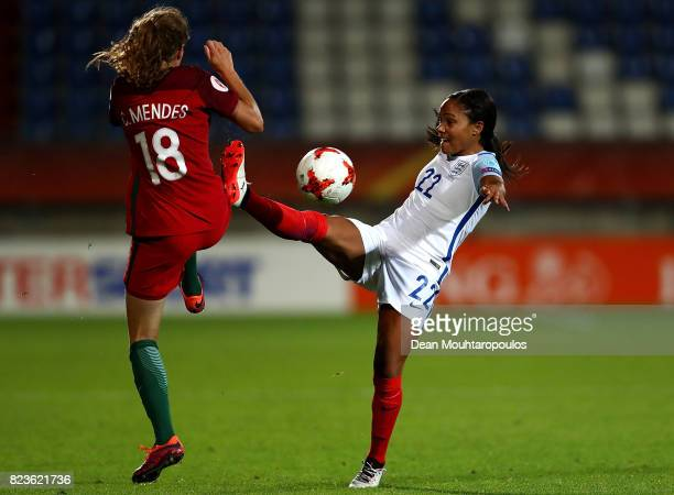Alex Scott of England and Carolina Mendes of Portugal battle for possession during the UEFA Women's Euro 2017 Group D match between Portugal and...