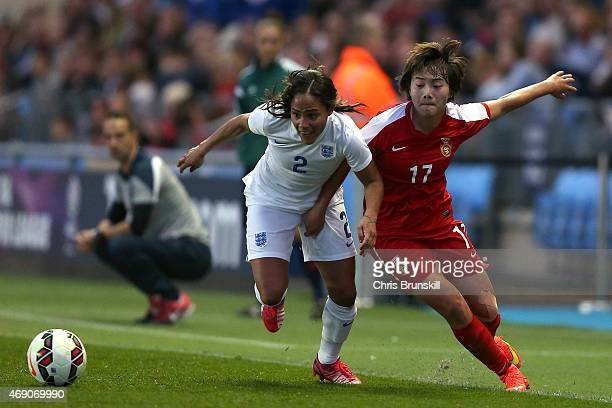 Alex Scott of England competes with Shuang Wang of China during the Women's Friendly International match between England and China at the Manchester...