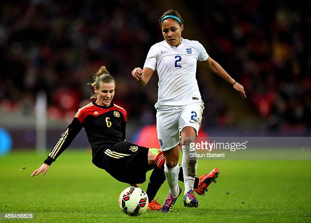 Alex Scott of England goes past the challenge from Lucy Bronze of England during the Women's International Friendly match between England and Germany...