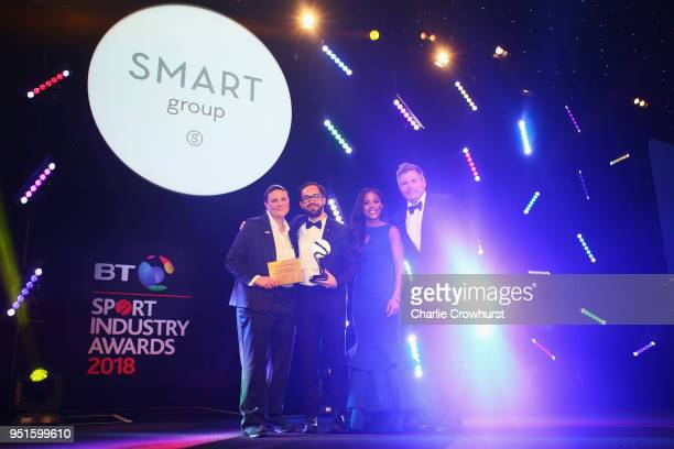 Alex Scott presents the Campaign of the Year award in association with Smart Group to Stonewall TeamPride during the BT Sport Industry Awards 2018 at...