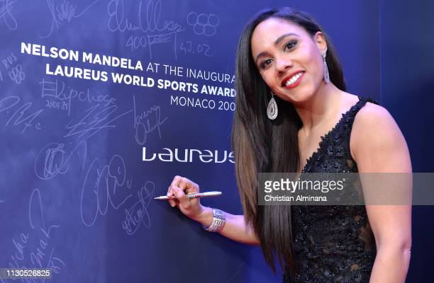 Alex Scott signs the Nelson Mandela wall during the 2019 Laureus World Sports Awards on February 18 2019 in Monaco Monaco