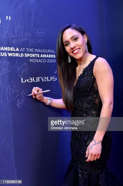 Alex Scott signs the Nelson Mandela wall during the 2019 Laureus World Sports Awards on February 18 2019 in Monaco Monaco