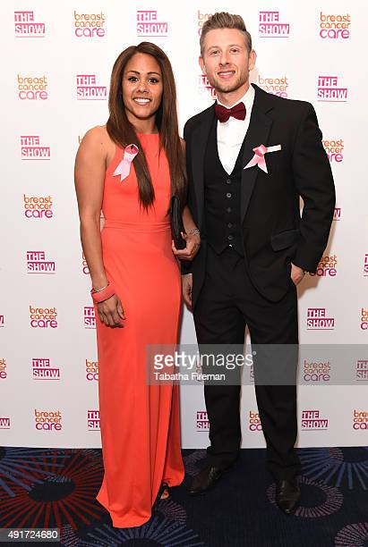 Alex Scott with partner attend Breast Cancer Care's London fashion show at Grosvenor House Hotel to launch Breast Cancer Awareness Month on October 7...