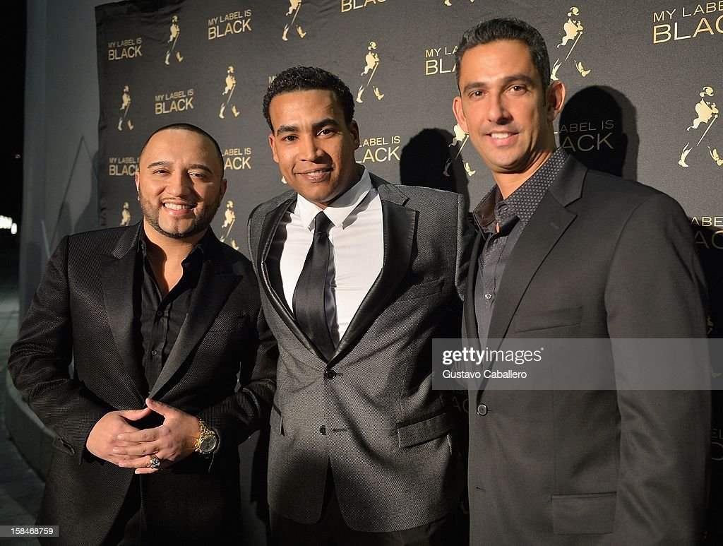 Alex Sensation, Don Omar and Jorge Posada attends the Johnnie Walker My Label is Black - at Bongos on December 13, 2012 in Miami, Florida.