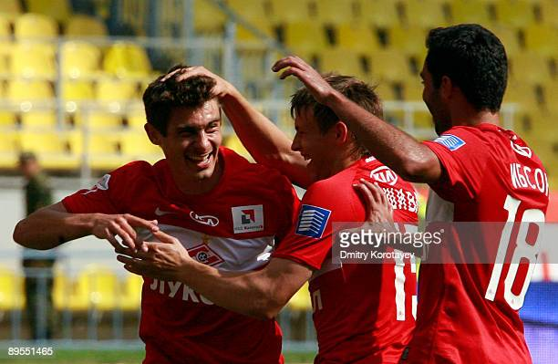 Alex Sergei Parshivlyuk and Ibson Barreto da Silva of FC Spartak Moscow celebrate scoring a goal during the Russian Football League Championship...