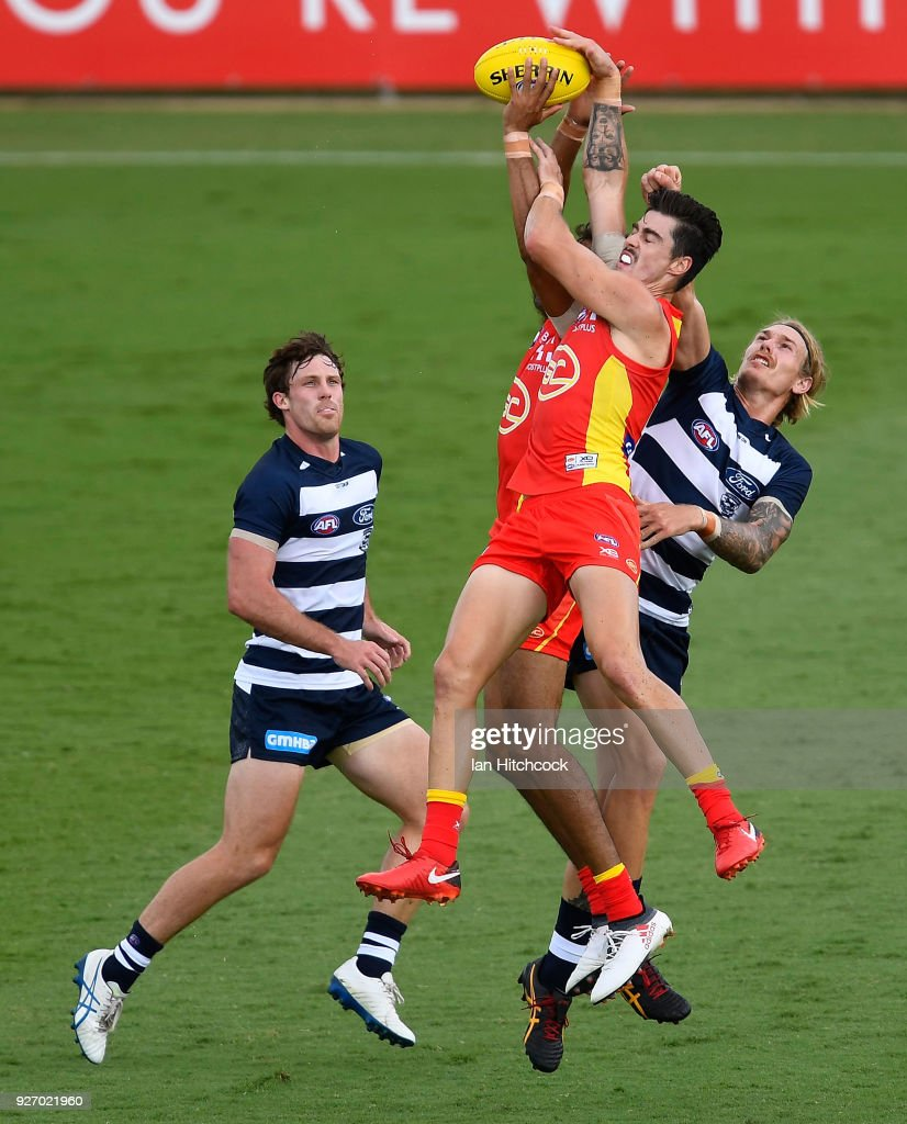 Alex Sexton of the Suns attmpts to take a mark in front of Tom Stewart of the Cats during the AFL JLT Community Series match between the Geelong Cats and the Gold Coast Suns at Riverway Stadium on March 4, 2018 in Townsville, Australia.
