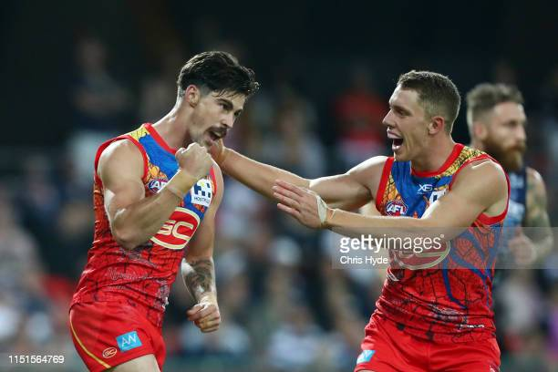 Alex Sexton of the Suns celebrates a goal during the round 10 AFL match between the Gold Coast Suns and the Geelong Cats at Metricon Stadium on May...