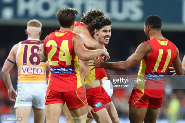 Alex Sexton of the Suns celebrates a goal during the round 22 AFL match between the Gold Coast Suns and Brisbane Lions at Metricon Stadium on August...