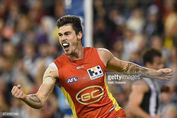 Alex Sexton of the Suns celebrates kicking a goal during the round eight AFL match between the Gold Coast Suns and the Collingwood Magpies at...