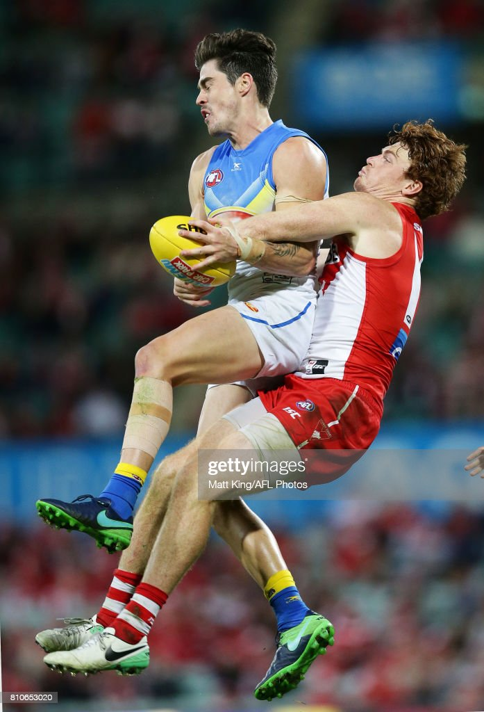 Alex Sexton of the Suns is challenged by Gary Rohan of the Swans during the round 16 AFL match between the Sydney Swans and the Gold Coast Suns at Sydney Cricket Ground on July 8, 2017 in Sydney, Australia.
