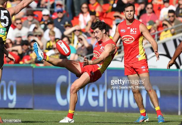 Alex Sexton of the Suns snaps a goal during the round 21 AFL match between the Gold Coast Suns and the Richmond Tigers at Metricon Stadium on August...