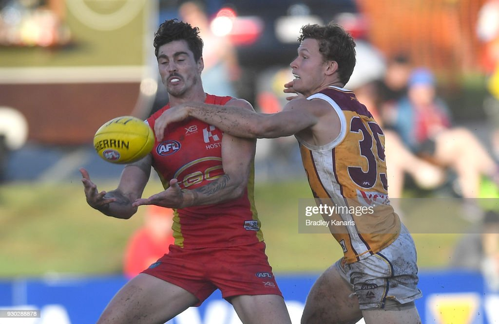 Alex Sexton of the Suns takes a mark during the JLT Community Series AFL match between the Gold Coast Suns and the Brisbane Lions at Fankhauser Reserve on March 11, 2018 in Brisbane, Australia.