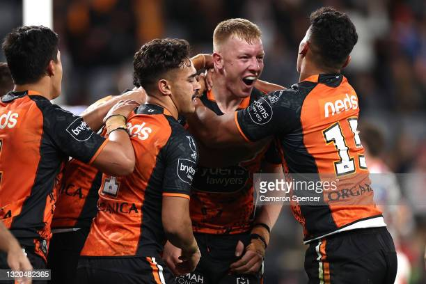 Alex Seyfarth of the Tigers celebrates with team mates after scoring a try during the round 12 NRL match between the Wests Tigers and the St George...