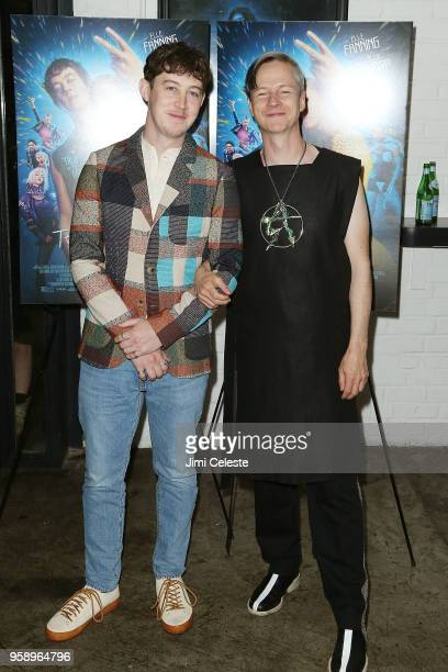 Alex Sharp and John Cameron Mitchell attend the New York premiere of 'How to Talk to Girls at Parties' at Metrograph on May 15 2018 in New York City