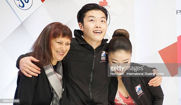 Alex Shibutan of the United States hugs is sister and parter Maia and their coach Marina Zueva while waiting for the results in the Ice Dance Short...