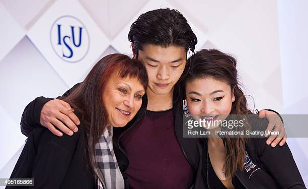Alex Shibutan of the United States hugs is sister and parter Maia and their coach Marina Zueva while waiting for the results in the Ice Dance Free...
