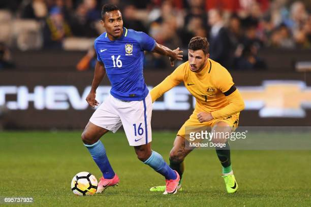 Alex Silva of Brazil controls the ball from Matthew Leckie during the Brasil Global Tour match between Australian Socceroos and Brazil at Melbourne...