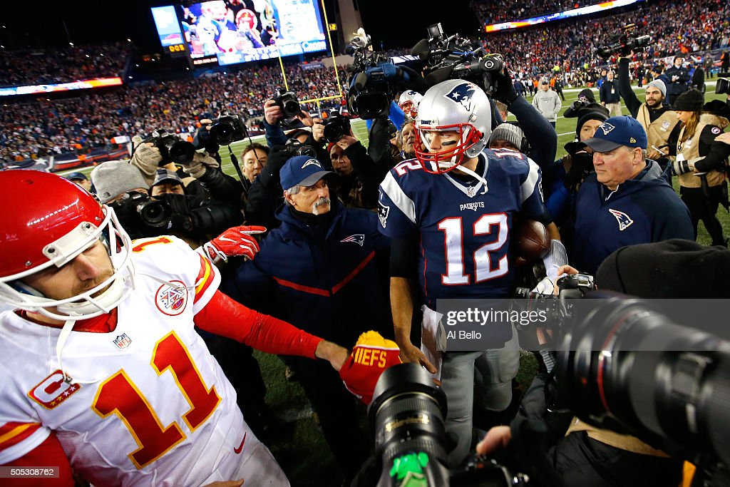 Alex Smith #11 of the Kansas City Chiefs and Tom Brady #12 of the New England Patriots speak while leaving the field after the AFC Divisional Playoff Game at Gillette Stadium on January 16, 2016 in Foxboro, Massachusetts. The Patriots defeated the Chiefs 27-20.