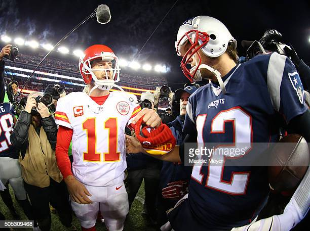 Alex Smith of the Kansas City Chiefs and Tom Brady of the New England Patriots speak after the AFC Divisional Playoff Game at Gillette Stadium on...