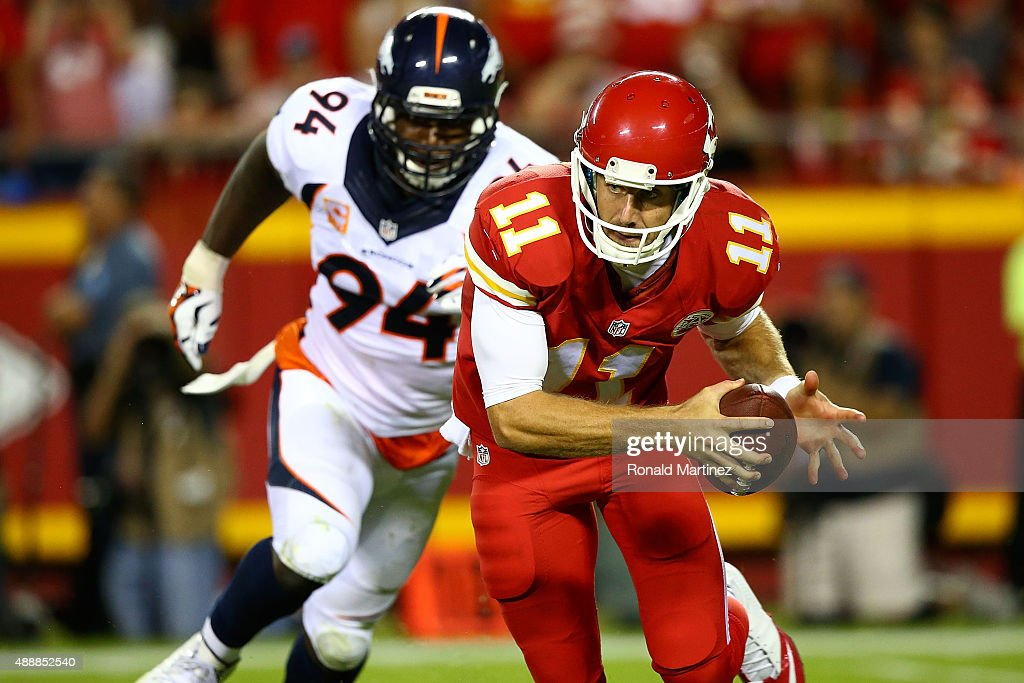 Alex Smith #11 of the Kansas City Chiefs avoids the rush of DeMarcus Ware #94 of the Denver Broncosduring the game at Arrowhead Stadium on September 17, 2015 in Kansas City, Missouri.