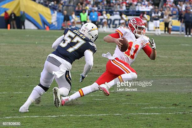 Alex Smith of the Kansas City Chiefs avoids the tackle against Jatavis Brown of the San Diego Chargers during a NFL game at Qualcomm Stadium on...