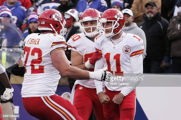 Alex Smith of the Kansas City Chiefs celebrates a touchdown with Eric Fisher of the Kansas City Chiefs and Anthony Fasano of the Kansas City Chiefs...