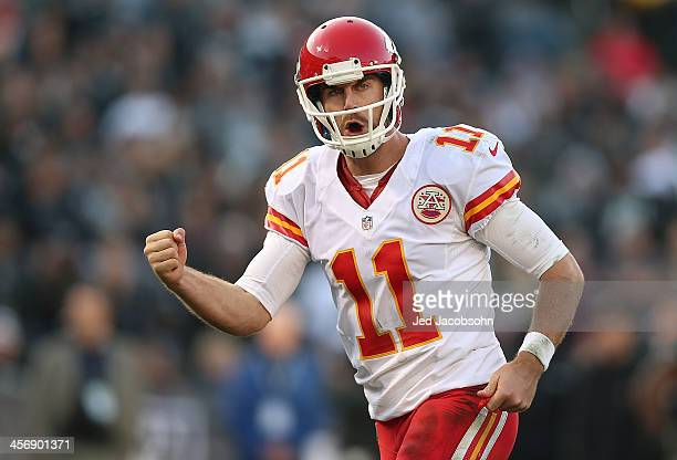 Alex Smith of the Kansas City Chiefs celebrates after a touchdown against the Oakland Raiders at Oco Coliseum on December 15 2013 in Oakland...
