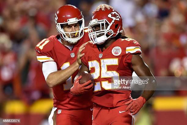 Alex Smith of the Kansas City Chiefs celebrates teammate Jamaal Charles touchdown run during a game against the Denver Broncos at Arrowhead Stadium...