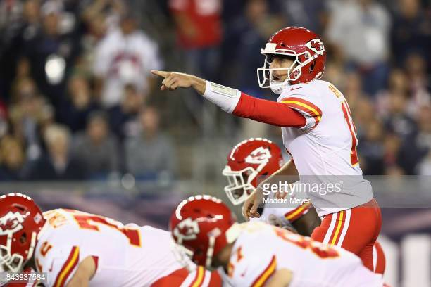 Alex Smith of the Kansas City Chiefs gestures at the line of scrimmage during the second half against the New England Patriots at Gillette Stadium on...