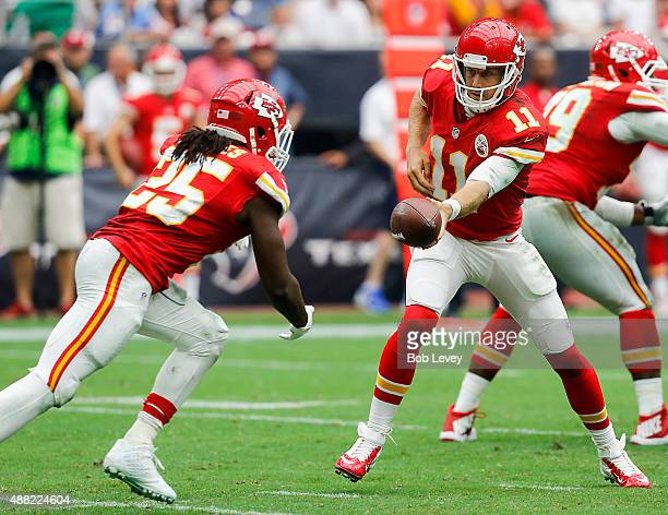 Alex Smith of the Kansas City Chiefs hands off to Jamaal Charles against the Houston Texans at NRG Stadium on September 13 2015 in Houston Texas